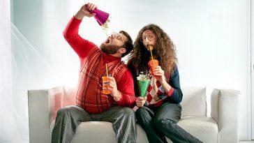 Two geeks eating popcorn